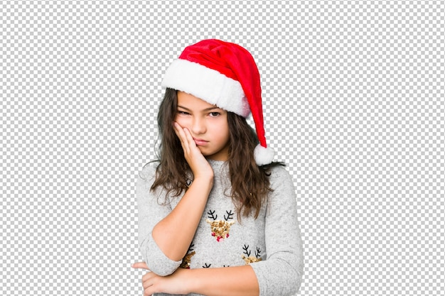 Kleines mädchen, das weihnachtstag feiert, der gelangweilt, ermüdet ist und einen entspannungstag benötigt.