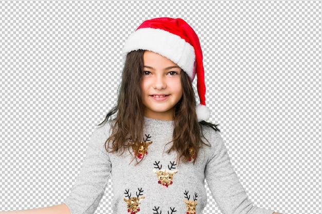 Kleines mädchen, welches den weihnachtstag zeigt einen willkommenen ausdruck feiert.