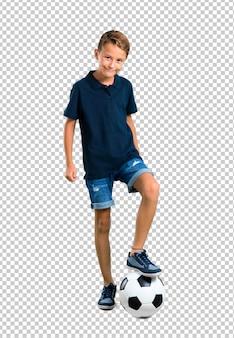 Kleinkind, das fußball spielt