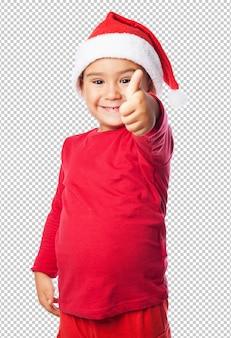 Kleinkindjunge, der weihnachten feiert