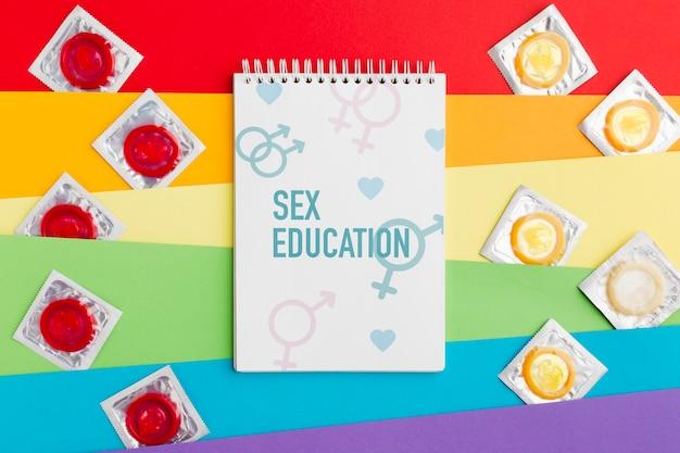 Kondome auf regenbogen-designhintergrund