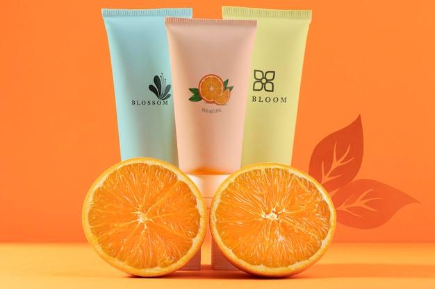 Kosmetikarrangement mit orange Kostenlosen PSD