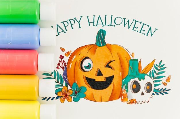 Künstlerisches glückliches halloween-design auf papierblatt