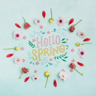 Künstlerisches hallo frühlingsblumenrahmenkonzept