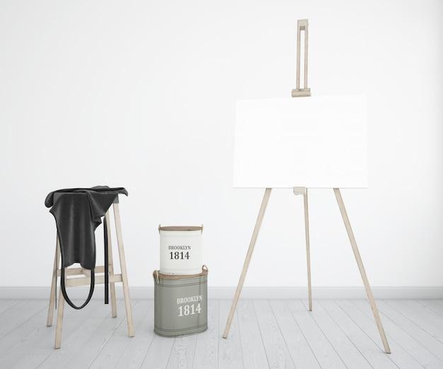 Kunstatelier mit leinwand, schürze und farbflaschen
