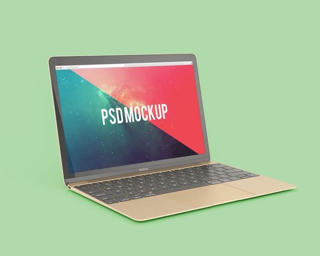 Laptop auf grünem hintergrund mock up