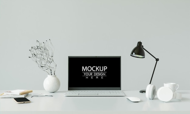 Laptop auf schreibtisch im arbeitsbereichmodell