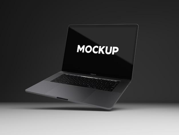 Laptop auf schwarzem hintergrund mock up design