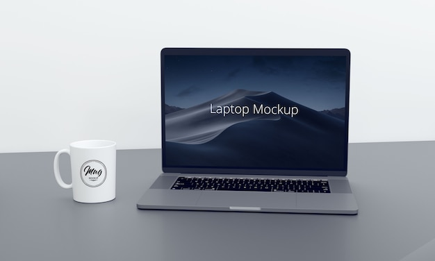 Laptop mit kaffeetasse modell