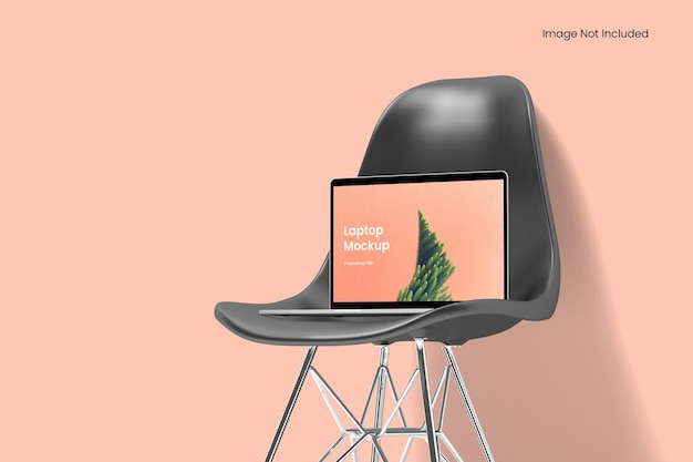 Laptop-modell auf dem stuhl