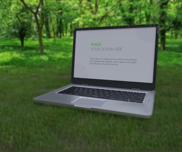 Laptop-modell in grüner natur