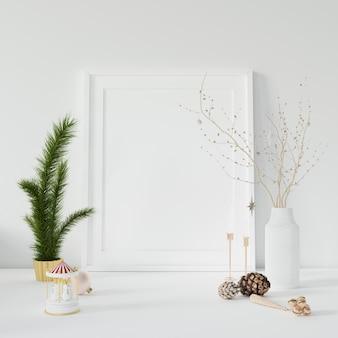 Leerer fotorahmen und dekorative zweige