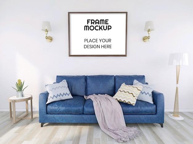 Leeres fotorahmenmodell mit pflanze und blauem sofa