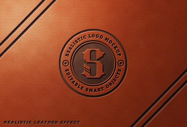 Logo-mockup aus gepresstem leder auf orangem leder