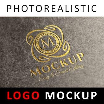 Logo mockup - graviertes goldenes logo auf steinschilder