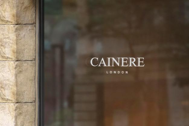 Logo mockup luxus fenster zeichen steinmauer