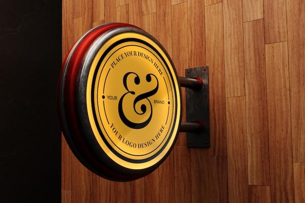 Logo-modell auf holzwand