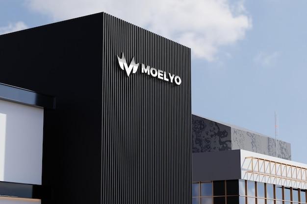 Logo-modell auf schwarzem fassadengeschäft-bürogebäudezeichen