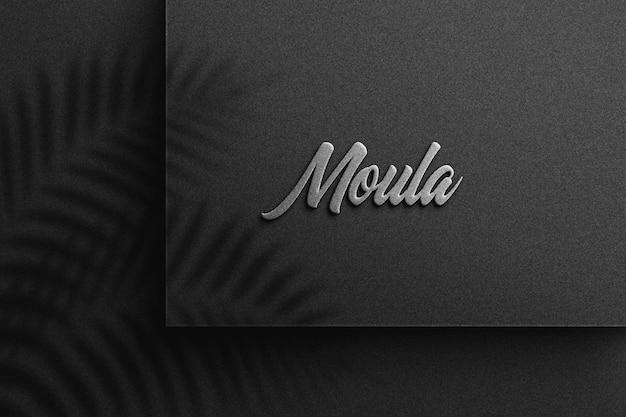 Logo-modell auf schwarzem papier