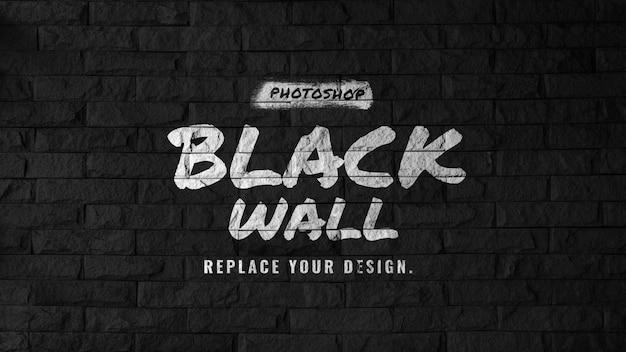 Logo-modell auf schwarzer backsteinmauer