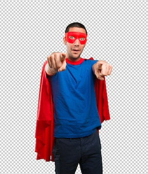 Lustiger superheld, der sie zeigt