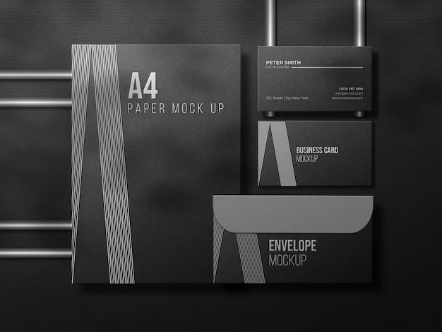 Luxuriöses dunkles schreibwaren-mockup-set mit prägeeffekt