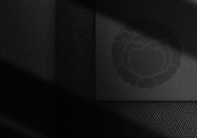 Luxuriöses schwarz geprägtes logo-modell