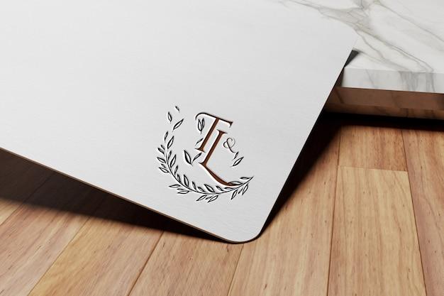 Luxus-logo-modell auf schwarzem weißem papier