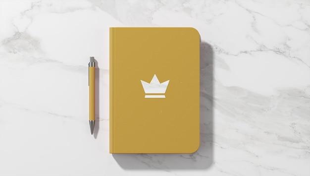 Luxus-logo-modell auf weißem marmorhintergrund des gelben tagebuchs