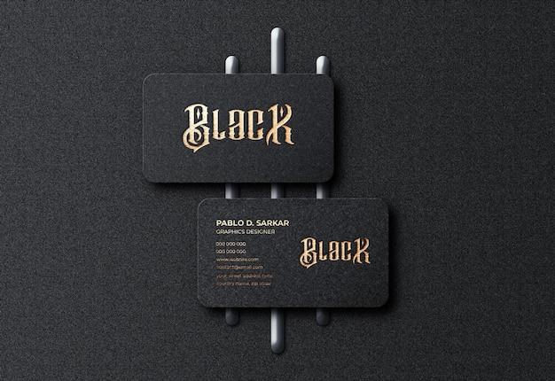 Luxus schwarz visitenkarte und logo modell premium psd