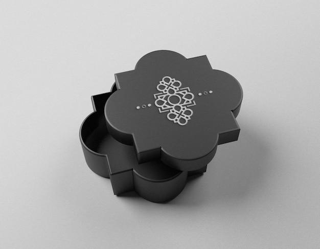 Luxus-silberfolien-logo-modell auf dunkler schmuckschatulle
