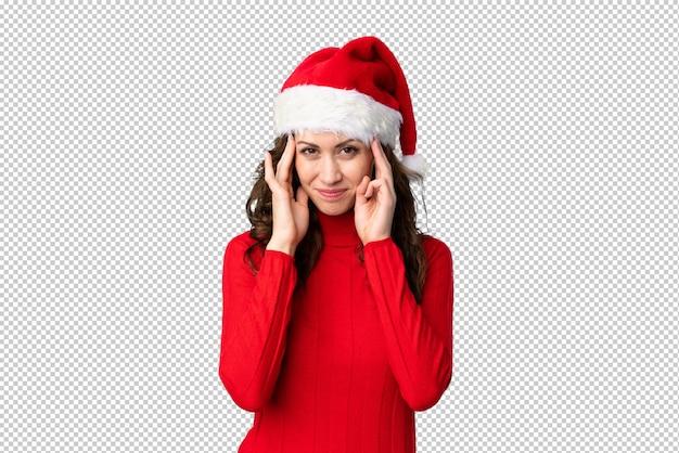 Mädchen mit dem weihnachtshut unglücklich und mit etwas, negativer gesichtsausdruck frustriert