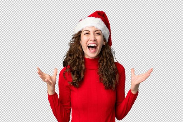 Mädchen mit weihnachtsmütze unglücklich und mit etwas frustriert