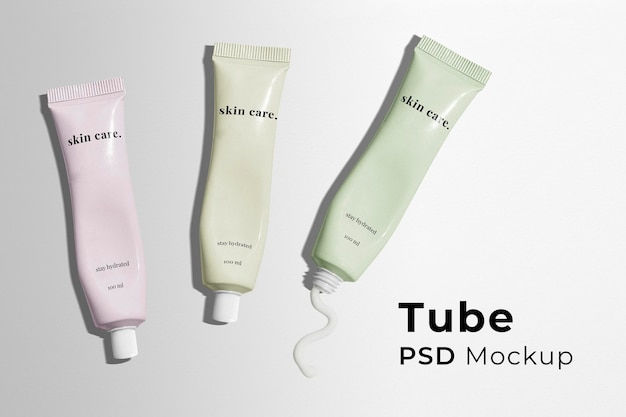 Make-up tube mockup psd mit box für beauty-produkte im pastell-design
