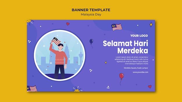 Mann, der malaysische flaggenfahnen-webschablone steht und hält