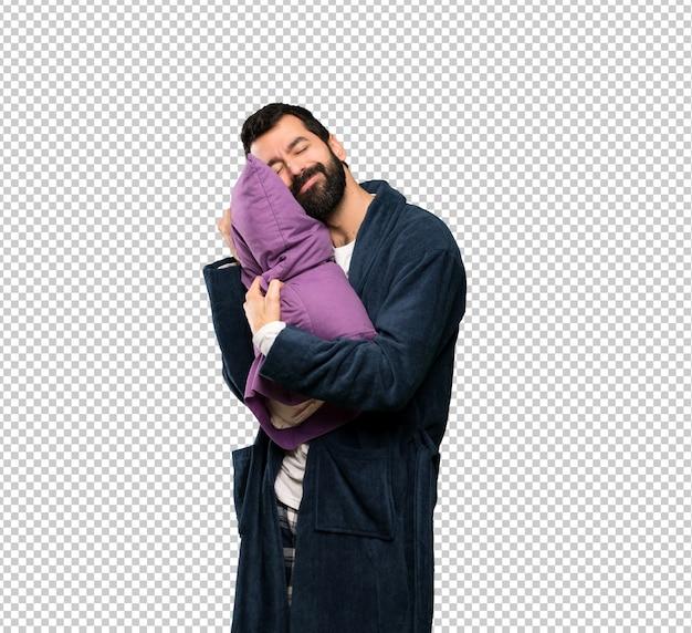 Mann mit bart in den pyjamas, die schlafgeste im dorable ausdruck machen lassen