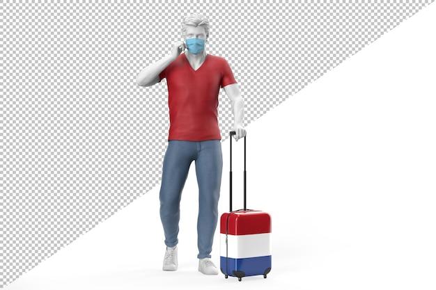 Mann mit gesichtsmaske zieht einen koffer mit der flagge der niederlande