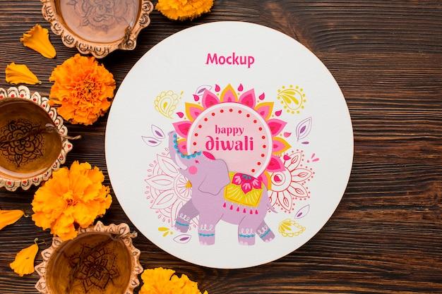Mock-up diwali hindu festival mit gezeichneten elefanten auf teller