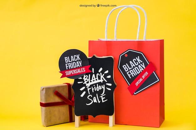 Mockup für schwarzen freitag mit geschenk und tasche Kostenlosen PSD