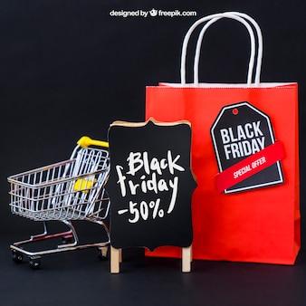Mockup für schwarzen freitag mit tasche und wagen Kostenlosen PSD