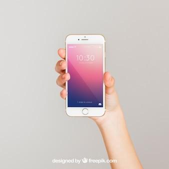 Mockup konzept der hand zeigt smartphone