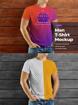 Mockup männliche t-shirts design auf holzwand