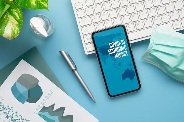 Mockup mobilephone für covid-19-konzept für wirtschaftliche auswirkungen.