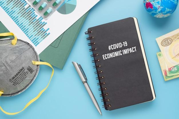 Mockup notebook für covid 19 wirtschaftliche auswirkungen