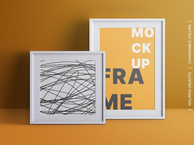 Mockup von zwei rechteckigen und quadratischen innenleinwandrahmen-fotopostern isoliert
