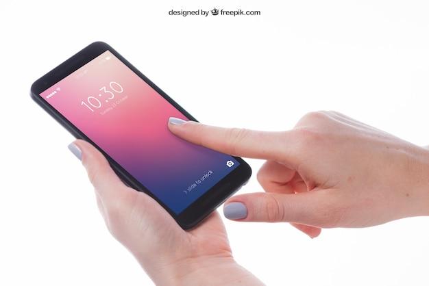 Modell des fingers zeigend auf smartphone