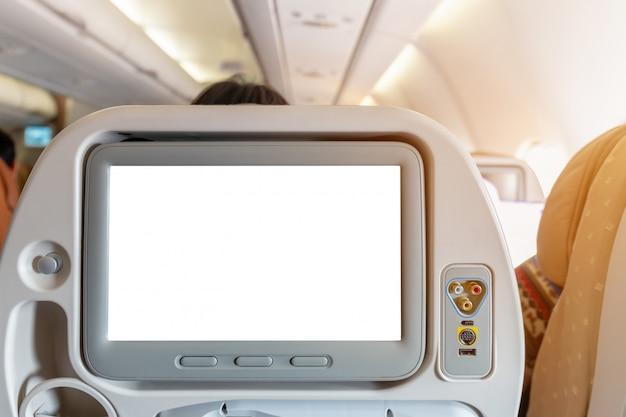 Modell des flugzeugmonitors auf kabine im innenraum der passagiersitzfläche