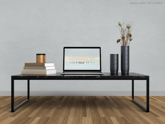 Modell-laptop, der auf dem modernen innenhintergrund des raumes steht