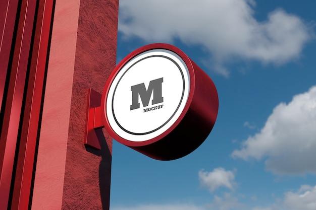 Moderne runde runde beschilderung des logo-zeichenmodells im außenbereich mit blauem himmel