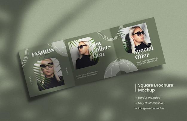 Moderne und minimalistische geöffnete quadratische dreifach gefaltete broschüre oder zeitschriftenmodell mit vorlagen-layout-design